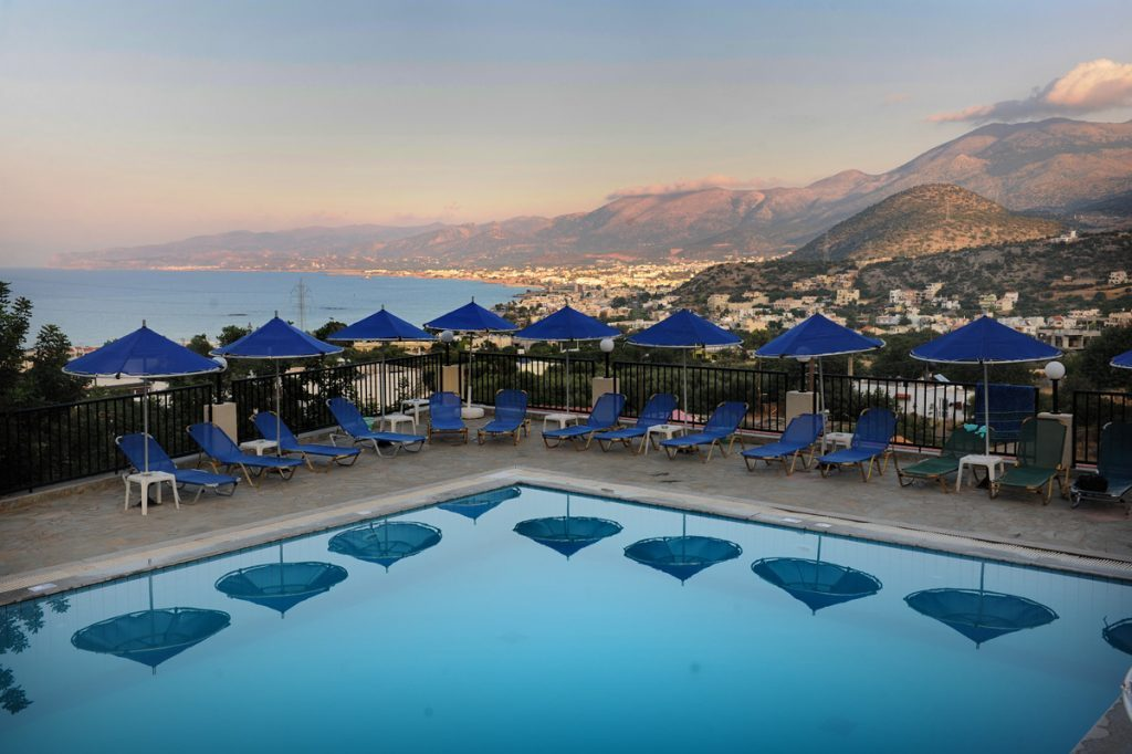 bella vista apts the pool during sun set