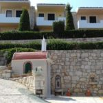 pelagos villas the the outside view with a small church