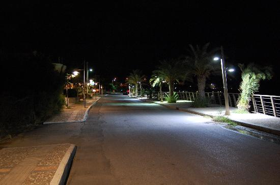dionysos apts the coast road next to the apts by night